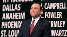 NHL Commissioner Gary Bettman looks up in fron