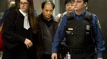 Daran Lin, father of murder victim Jun Lin, leaves the courtroom in Montreal on Tuesday, March 12, 2013. (Ryan Remiorz/THE CANADIAN PRESS)