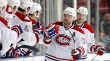 Montreal Canadiens' Andrei Markov (C) and Benoit Pouliot (R) celebrate a goal during the second period of an NHL hockey game against the Tampa Bay Lightning in Tampa, Florida December 30, 2009. (MIKE CARLSON/REUTERS)