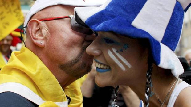 A Germany soccer fan kisses a Greece fan ahead of the Euro 2012 soccer match between Germany and Greece (KACPER PEMPEL/REUTERS)
