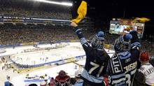 Pittsburgh Penguins fans cheer on their team in the first period against the Washington Capitals during the NHL's Winter Classic hockey game at Heinz Field in Pittsburgh, Pennsylvania January 1, 2011. (Reuters)