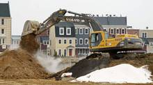 Multi-unit buildings under construction are seen in Alexandria, Virginia February 16, 2012. (KEVIN LAMARQUE/REUTERS)
