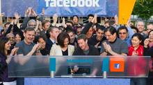 Facebook founder, Chairman and CEO Mark Zuckerberg, centre, rings the opening bell of the Nasdaq stock market in May. (Zef Nikolla/Associated Press)