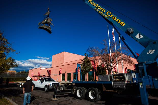 Workers remove a statue depicting two Confederate soldiers one of whom holds the Confederate battle flag, from the campus of Dixie State College on Wednesday, Dec. 6, 2012.