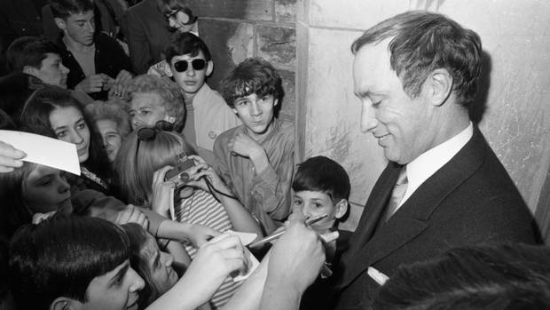 Pierre Trudeau signs autographs for crowd of admirers in Ottawa on April 20, 1968, the day of his swearing in as prime minister of Canada. Mr. Trudeau, who replaced prime minister Lester Pearson after his resignation, ran in a general election two months later and won a majority government.