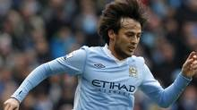 Manchester City's David Silva runs with the ball during their English Premier League soccer match against Wolverhampton Wanderers at the Etihad Stadium in Manchester, northern England October 29, 2011. REUTERS/Phil Noble (Phil Noble/Reuters)