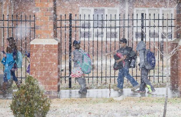 Students at Lone Oak Elementary School walk to classes in the morning amid snow flurries in Paducah, Ky., on Feb. 24, 2016.