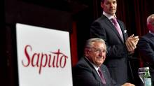 Saputo president and CEO Lino Saputo Jr., right, and his father Lino, chairman of the board, get set for the the company's annual meeting in Laval, Que., on Tuesday, July 31, 2012. (Paul Chiasson/THE CANADIAN PRESS)