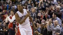 Toronto Raptors' Kyle Lowry celebrates scoring against New York Knicks during second half NBA action in Toronto on Saturday December 28, 2013. (Chris Young/THE CANADIAN PRESS)