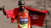 Wilson Kipsang of Kenya celebrates after winning the men's London Marathon April 22, 2012. REUTERS/Suzanne Plunkett (Suzanne Plunkett/Reuters)