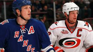 rc Staal #18 of the New York Rangers skates against his brother Eric Staal #12 of the Carolina Hurricanes at Madison Square Garden on January 5, 2011 in New York City. (Photo by Bruce Bennett/Getty Images)