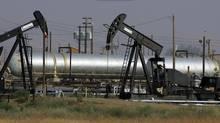 Oil well pump jacks. (Gary Kazanjian/Gary Kazanjian/AP)