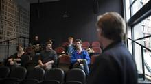 Fourth-year film student Andrew Gillingham, far right, 23, speaks during a filmmaking class as Professor Colin Browne stands by at the Simon Fraser University School for the Contemporary Arts in Vancouver on Jan. 24, 2013. (Rafal Gerszak for The Globe and Mail)