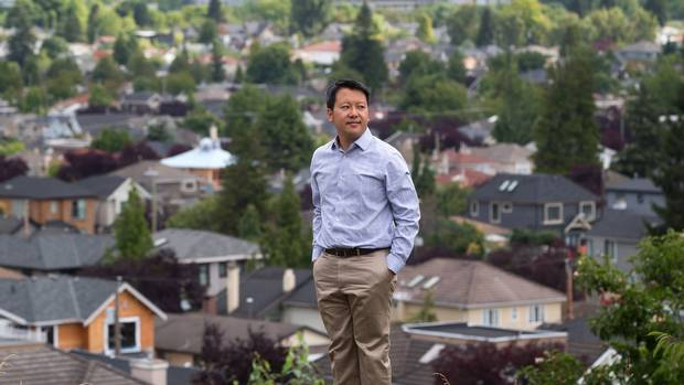 Justin Fung, a member of HALT - Housing Action for Local Taxpayers, stands for a photograph overlooking homes in Arbutus Ridge in Vancouver, B.C., on Thursday July 14, 2016.