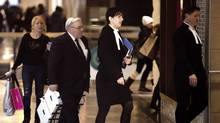 Accompanied by his lawyers, Winston Blackmore, third from right, makes his way into the Federal Tax Court in Vancouver on Monday, Jan. 23, 2012. (Rafal Gerszak/Rafal Gerszak for The Globe and)