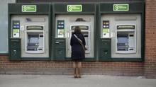 The NDP is pushing for a cap on automated bank-machine fees, while the governing Conservatives promise more no-fee banking. (FRED LUM/THE GLOBE AND MAIL)