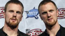 Twin brothers Daniel (L) and Henrik Sedin of the Vancouver Canucks arrive for the team draft for the NHL All-Star hockey game in Raleigh, January 28, 2011. The All-Star game will be played on Sunday. REUTERS/Shaun Best (SHAUN BEST)