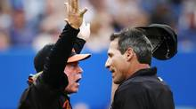 Baltimore Orioles manager Buck Showalter (L) argues a call with home plate umpire Angel Hernandez during a break in play against the Toronto Blue Jays during the second inning of their American League baseball game in Toronto June 21, 2013. (MARK BLINCH/REUTERS)