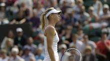 Maria Sharapova of Russia reacts during her Women's second round singles match against Michelle Larcher De Brito of Portugal at the All England Lawn Tennis Championships in Wimbledon, London, Wednesday, June 26, 2013. (Anja Niedringhaus/AP)