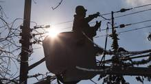 A line worker works to restore power in Toronto on Dec. 27, 2013. (CHRIS YOUNG/THE CANADIAN PRESS)