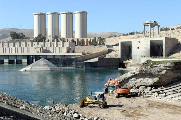Employees work at strengthening the Mosul Dam in northern Iraq, February 3, 2016.