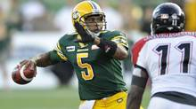 Edmonton Eskimos quarterback Kerry Joseph (L) throws a pass against the Calgary Stampeders during their CFL game in Edmonton September 7, 2012. (DAN RIEDLHUBER/REUTERS)