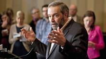 Thomas Mulcair takes questions from reporters during his first news conference as NDP Leader in Toronto on March 25, 2012. (Chris Young/Chris Young/The Canadian Press)