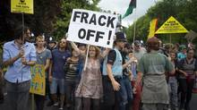 Demonstrators attempt to prevent police officers from escorting a lorry carrying oil drilling equipment to a site run by Cuadrilla Resources outside the village of Balcombe, England, on July 29 last year. The well is a conventional one that will not use fracking, but Cuadrilla has fracked elsewhere, and is one of a handful of companies with access to shale acreage that might be fracked in future, and so its activities have become a target for anti-fracking protests. (KIERAN DOHERTY/REUTERS)