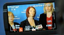 Australia's Prime Minister Julia Gillard, centre, flanked by local candidate Laura Smyth, right, and Jenny Macklin, minister for families, housing, community services and indigenous affairs. (WILLIAM WEST/AFP/Getty Images/WILLIAM WEST/AFP/Getty Images)