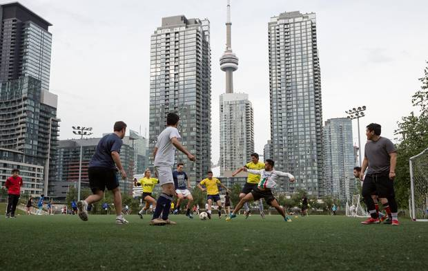 A soccer game takes place on the turf field at Canoe Landing Park in CityPlace