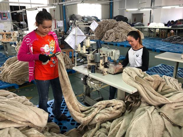 Cambodian workers make blankets and quilts at a Chinese-owned factory in the Sihanoukville Special Economic Zone, one of the most prominent of China's investments in Cambodia.