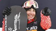 Canada's Maelle Ricker celebrates after winning the women's Snowboard-Cross FIS World Cup competition in Stoneham, Quebec, February 21, 2012. (MATHIEU BELANGER/REUTERS)