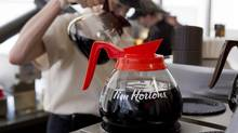 A server pours a cup of coffee at a Tim Hortons in Toronto. (Chris Young/THE CANADIAN PRESS)