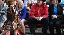 Prime Minister Stephen Harper, his wife Laureen (right) and his daughter Rachel (left) watch the annual Stampede parade during the 100th anniversary of the Calgary Stampede in Calgary, Alberta on July 6, 2012. (Todd Korol/REUTERS)