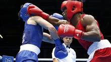 Canada's Custio Clayton (R) fights Britain's Freddie Evans during their Men's Welter (69kg) quarter-final boxing match at the London Olympic Games August 7, 2012. REUTERS/Murad Sezer (MURAD SEZER/REUTERS)