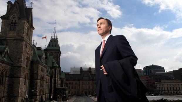 Finance Minister Bill Morneau stands on the front step of Parliament Hill on March 17.