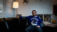 Vancouver Canucks' season ticket holder Earl Gordon poses for a photograph at his home in Vancouver, B.C., on Friday December 28, 2012. (DARRYL DYCK FOR THE GLOBE AND AMIL)