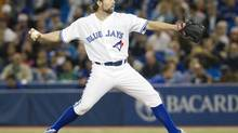 Toronto Blue Jays starting pitcher R.A Dickey throws against the Chicago White Sox in the first inning of their American League baseball game in Toronto April 18, 2013. (FRED THORNHILL/REUTERS)