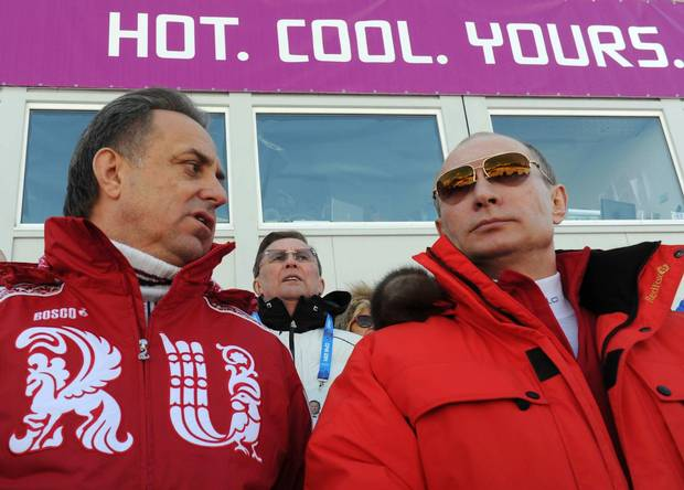 Russia's Minister of Sport Vitaly Mutko, left, with President Vladimir Putin, said the accusations were 'very made up' – but did report the disgraced head of the Moscow lab had been removed.