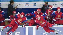 Russia teammates jump off their bench to celebrate after defeating Switzerland during a shoot out during quarter-final IIHF World Junior Championships hockey action in Ufa, Russia on Wednesday, Jan. 2, 2013. (Reuters)