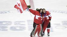 Team Canada's goalie Shannon Szabados and Hayley Wickenheiser celebrate after winning the gold medal in women's hockey at the Sochi Winter Games. (JOHN LEHMANN/THE GLOBE AND MAIL)