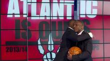 Toronto Raptors President and General Manager Masai Ujiri and head coach Dwane Casey hug each other (Galit Rodan/The Canadian Press)