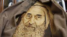 A portrait of Hamas founder and spiritual leader Sheik Ahmed Yassin is seen on a wheelchair at his house in Gaza City, Monday, May 30, 2011. Hamas and the Yassin's family opened his home to visitors, turning the location into a memorial site. Yassin was killed in an Israeli airstrike in 2004. (Hatem Moussa/AP)