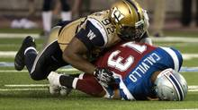Winnipeg Blue Bombers defensive tackle Bryant Turner sacks Montreal Alouettes quarterback Anthony Calvillo during third quarter CFL football action in Montreal on July 4, 2013. Bryant Turner had a few scary moments but the defensive player of the week is hoping to be back soon after an injury in the Bombers win in Montreal. (Paul Chiasson/THE CANADIAN PRESS)