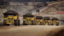 Caterpillar trucks working in the oil sands in Alberta, Canada. (Handout/Caterpillar Inc./Handout/Caterpillar Inc.)