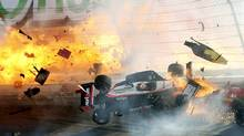 Will Power's car hits the wall as flames from British driver Dan Wheldon's car burst (at left) during the IZOD IndyCar World Championship race at the Las Vegas Motor Speedway in Las Vegas, Nevada October 16, 2011. Wheldon died from injuries sustained in the crash. (REUTERS/Barry Ambrose)