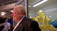 Toronto Mayor Rob Ford took in his likeness in butter during a family trip to the CNE, on Aug. 30. Mr. Ford also met artist Olenka Kleban and praised her work. (Galit Rodan/The Globe and Mail)
