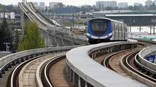 A SkyTrain pulls into the Marine Drive SkyTrain station in Vancouver on August 13, 2012. (Jeff Vinnick for The Globe and Mail)