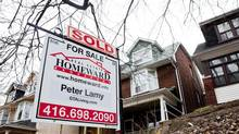 A real estate sign is posted in Toronto's east-end neighbourhood of The Beach, February, 2012. (For The Globe and Mail)