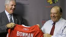 ven-time Stanley Cup champion Scotty Bowman, right, is joined by Chicago Blackhawks general manager Dale Ta